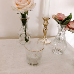 Elegant glass tea light holders with gold rims available from The Wedding of my Dreams