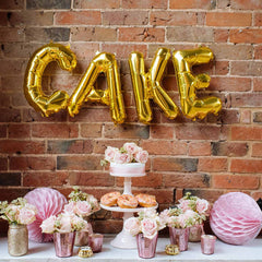 gold cake balloons weddings