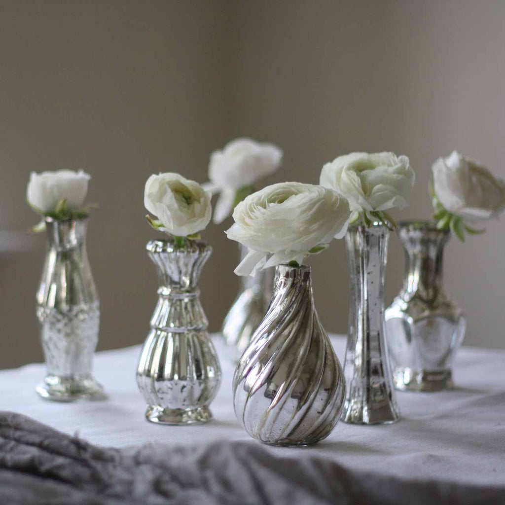 Grouping of mercury silver vases for weddings available from @theweddingomd