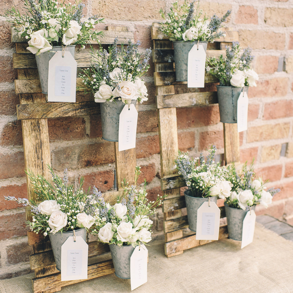 Rustic Wedding Table Plan With Flower Pots The