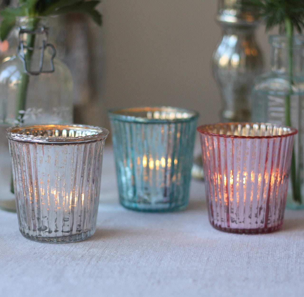 We carry a quality selection of Tealight Holders specifically designed for these tiny candles. Fill them with sand or other decorative elements and place your tea lights in the center. Choose from glass, metal, ceramic and wax holders that best suit your desired look.