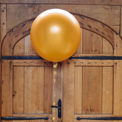 large gold round balloons
