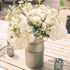 milk churns wedding centrepieces