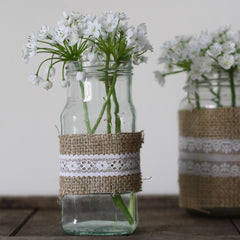 white lace ribbon decorate wedding jam jar vases