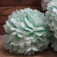 mint green tissue paper pom poms
