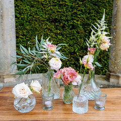 clear pressed glass vases and tea light holders for weddings