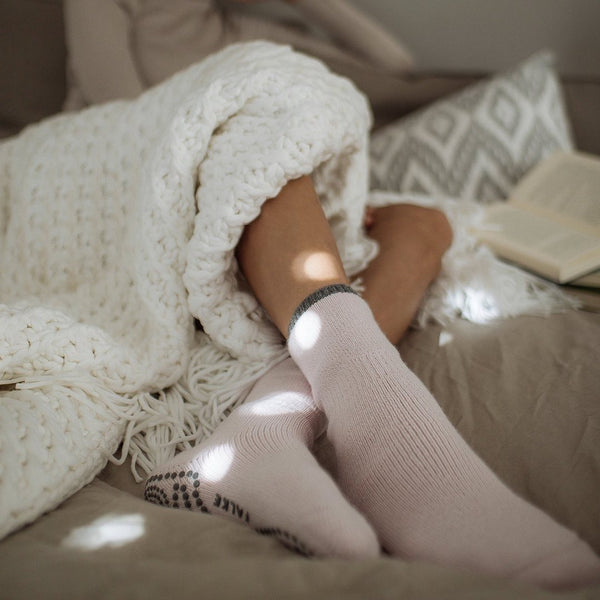 Falke, cuddle pad socks, slipper socks, grip bottom, blush pink, with a grey trim at the ankle, Caroline Randell.