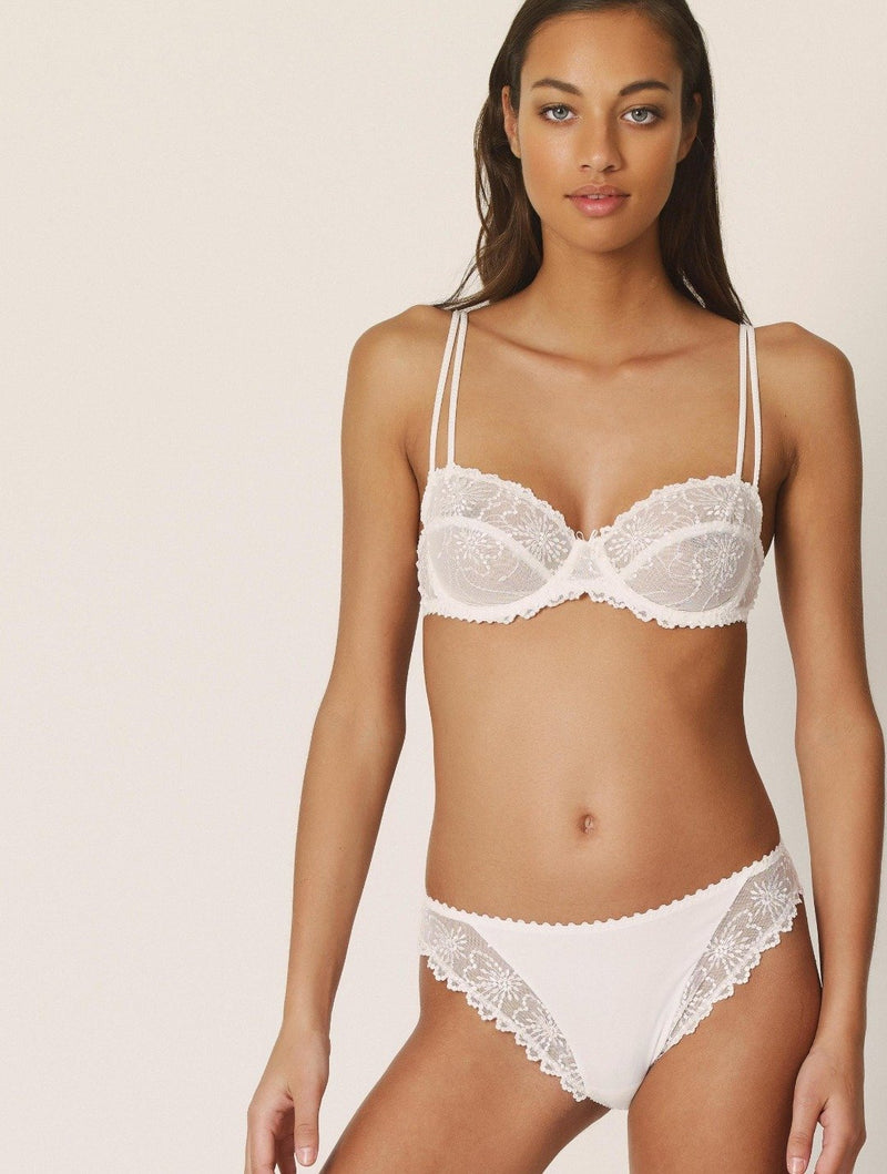 Marie Jo Jane balcony, underwired bra. Non padded with a double strap and embroidered lace cup in natural at Caroline Randell.