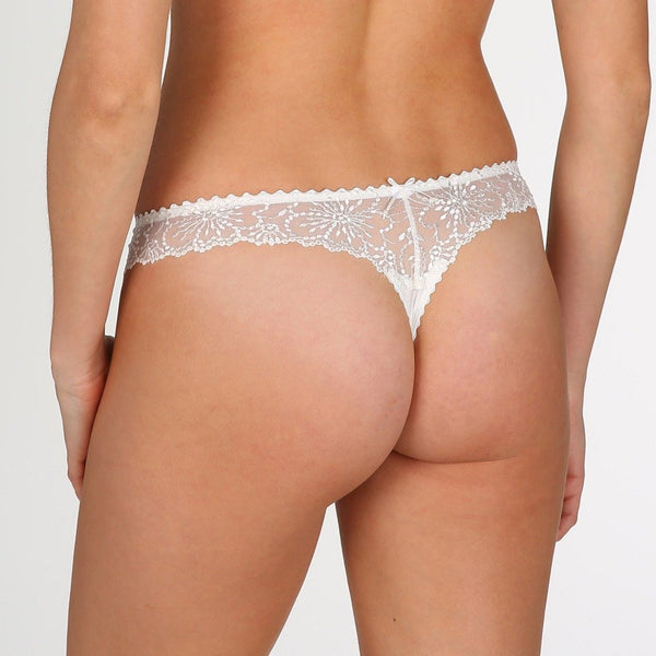 Marie Jo Jane thong with embroidery transparent lace. With a small bow detail on the back in natural at Caroline Randell.