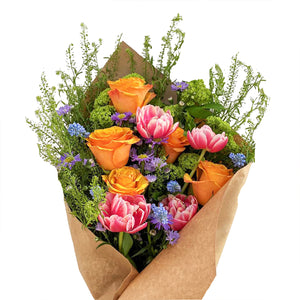 A lively bundle of blooms such as roses, hydrangea, and tulips.