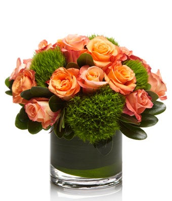 A cute arrangement of Coral and Peach Roses- H.Bloom