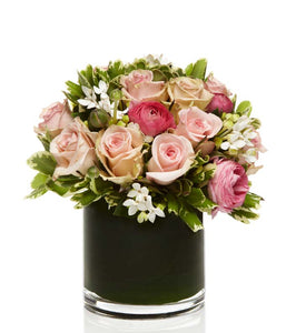 A Lush all Pink Arrangement with Pink Roses and Ranunculus accented with Seasonal Greens