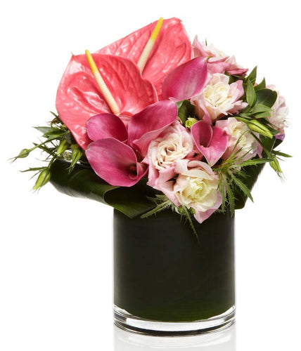 A beautiful all pink arrangement of Pink Anthurium, Calla Lilies, and Roses elegantly arranged