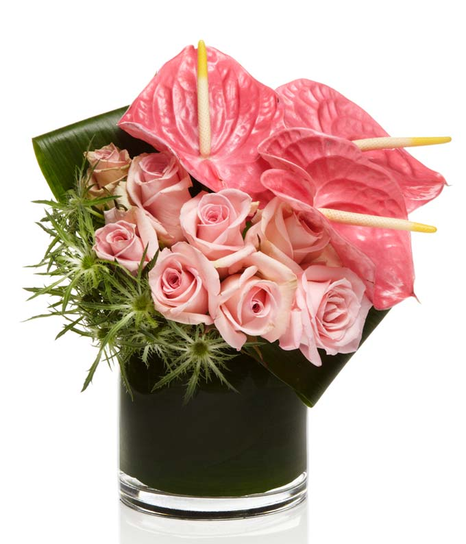 A luxury all pink arrangement with roses and orchids