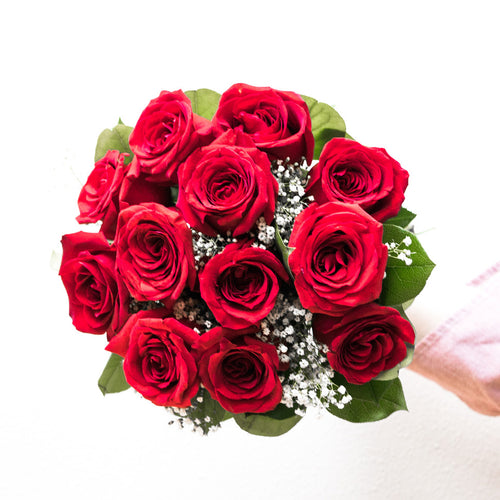 A classic arrangement of 12 stems of premium fresh red roses.