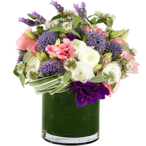 A garden-style mixed arrangement of purple, pink and white blooms with modern greenery.