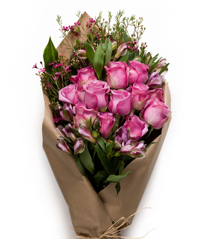 Pink and Purple Roses and Seasonal Flowers wrapped in a neat bundle - H.Bloom