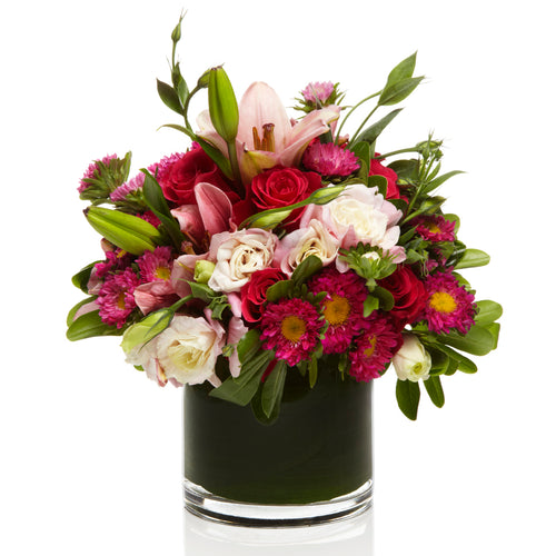 A cute arrangement of Pink Lilies, Aster and Roses - H.Bloom