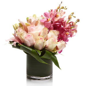 A luxury arrangement of Pink Roses and Pink Orchids- H.Bloom