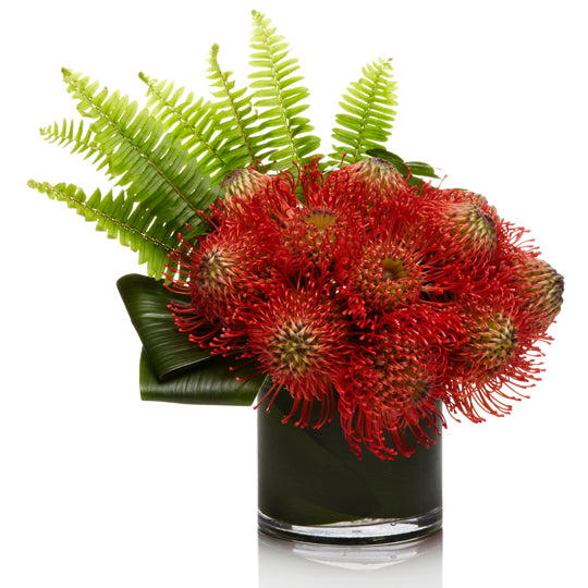 An Arrangement of Red and Orange Pincushion Protea with Tropical Greens- H.Bloom