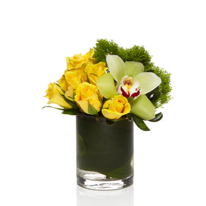 A cute arrangement of Green Dianthus, Yellow Roses and Green Orchids - H.Bloom