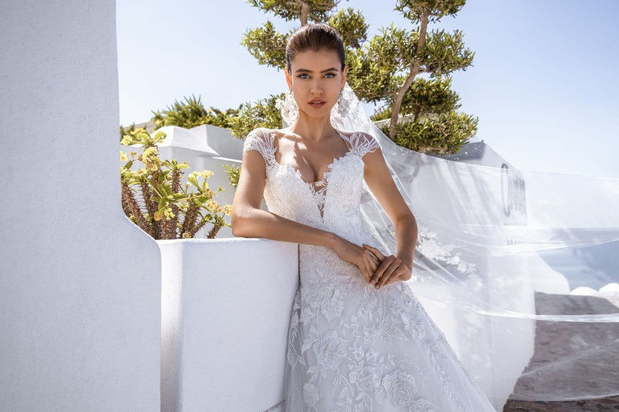 "Fluffy wedding dress of classic ""A""-silhouette. The back with the lacing emphasizes slimness of the bride. The dress is decorated with hand embroidery with beads, pearls and sequins."