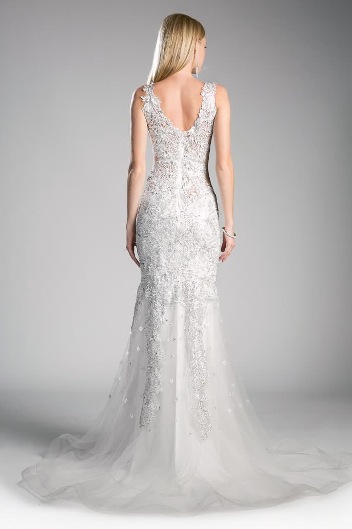 Renee wedding dress has a strong fan-base and showcases strategically placed novelty lace with metallic thread with dramatic mermaid tail. Beaded Flower Applique Novelty Gown
