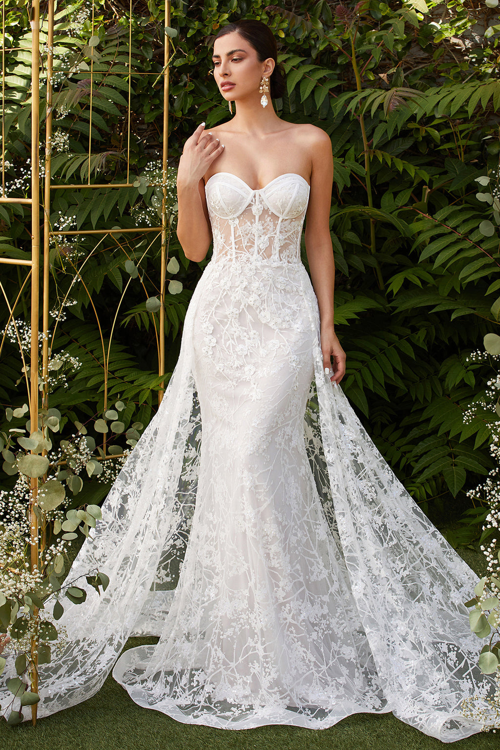 Strapless fitted off-white gown with floral applique and glitter tulle overskirt