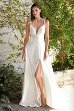 Carlie This satin, minimalist gown with eyes-here-neckline & leg slit is a beautiful classic choice for any woman - KC Haute Couture Wedding Dress