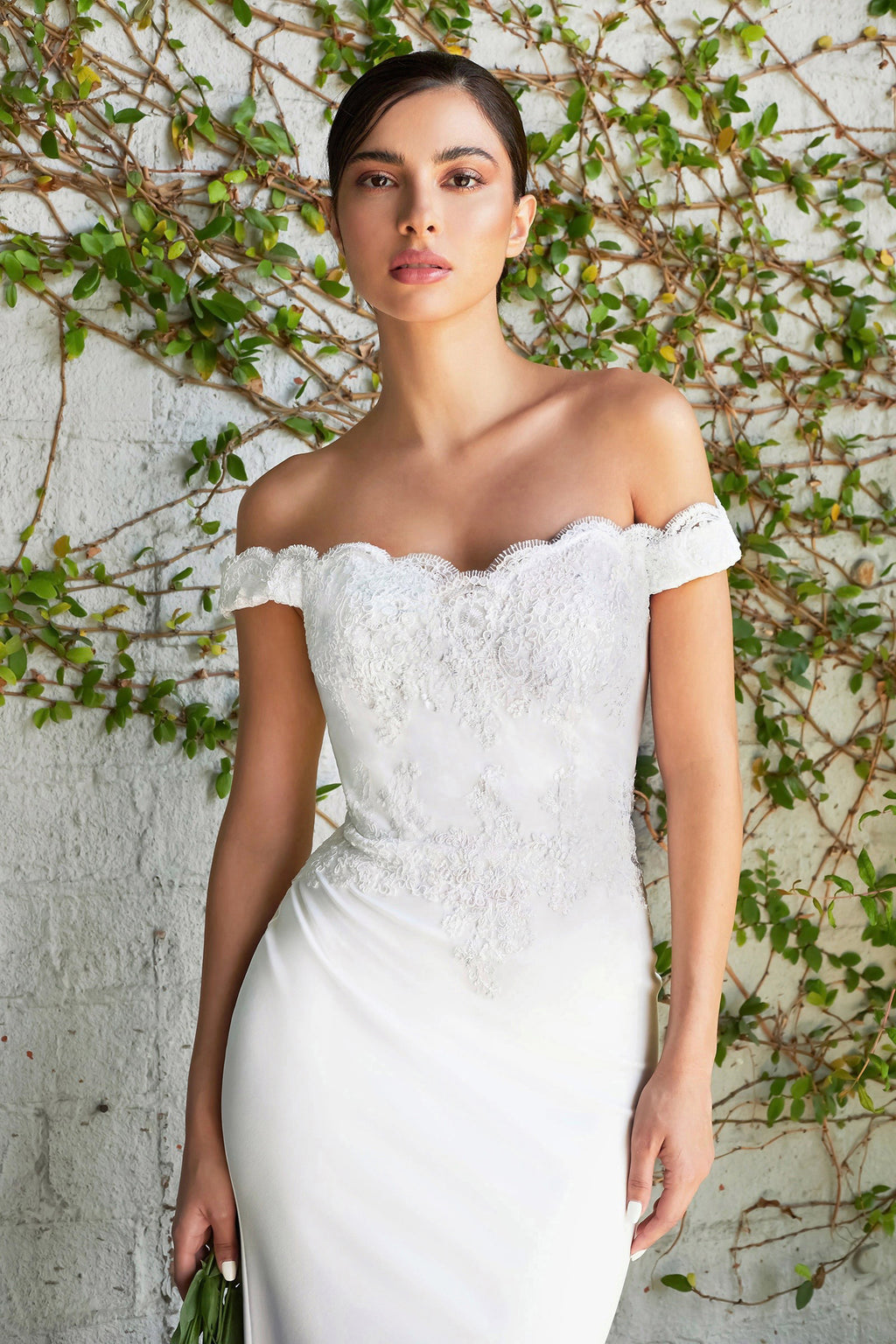 Kellyn Off the shoulder fitted gown with lace applique details and stretch jersey