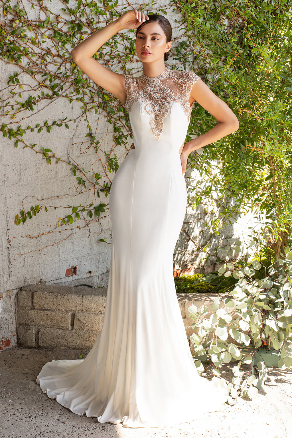 This gown shows off the beautiful curve of the back, as the embellishment frames the wearer and the back tail elongates her walk down the aisle.