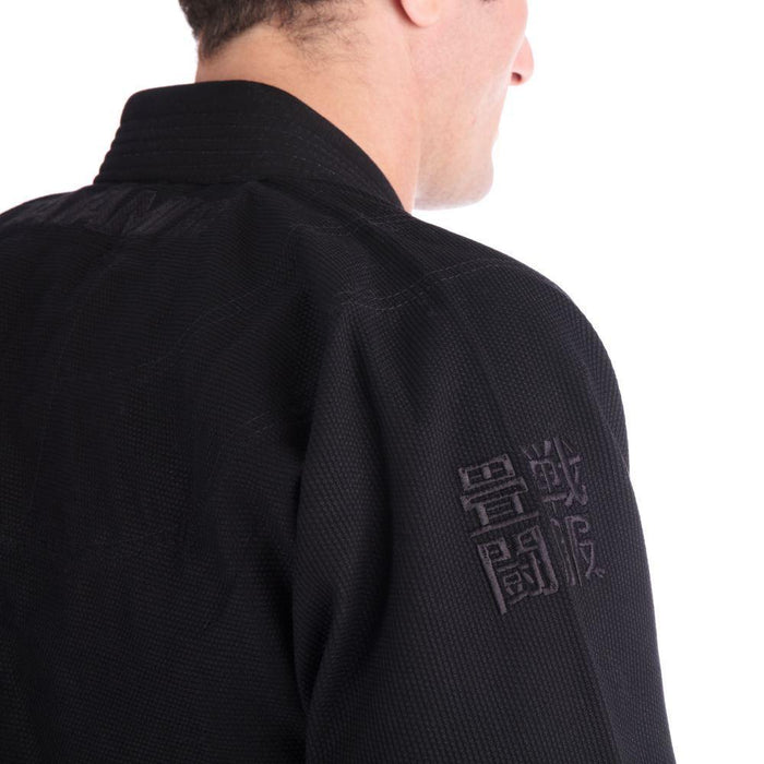 Tatami Essential BJJ Gi black back jacket right closeup