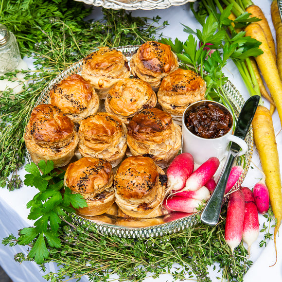 Mini slow roast Lamb shoulder & charmoulah pies with tomato harissa relish to dip