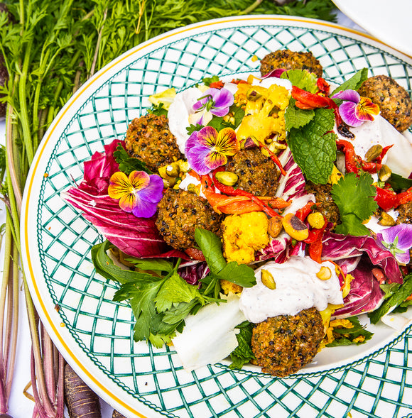 Black quinoa falafel salad with sumac yogurt dressing & pinenut dhukka