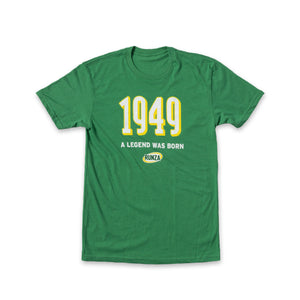 "Kelly Green T-Shirt with ""1949"" in large block letters and ""A Legend Was Born"" below. A Runza® logo is below both items."