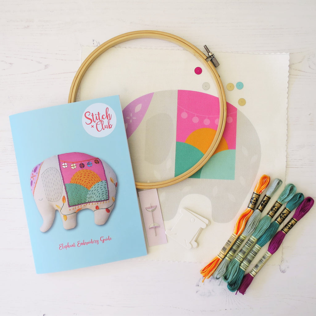 A sewing kit with a selection of threads, needles and an embroidery hoop