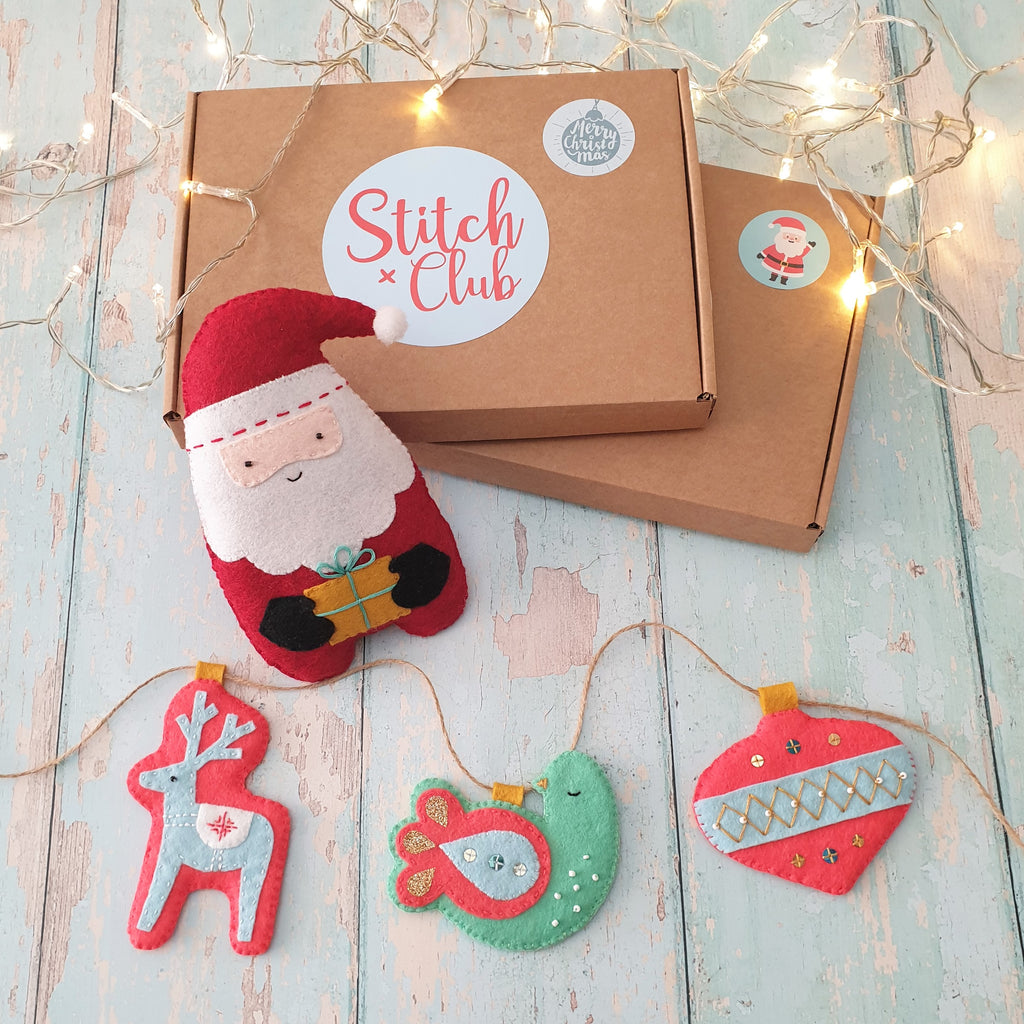 A selection of handsewn Christmas ornaments from a Christmas sewing kit by Stitch Club. Sew a festive felt garland which includes a reindeer, a partridge and a bauble