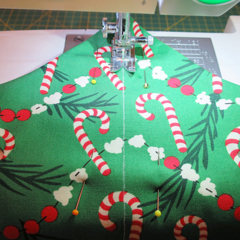 sewing a Christmas tree with festive fabric
