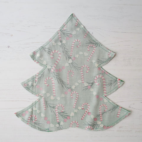 sewing together the layers of a christmas tree