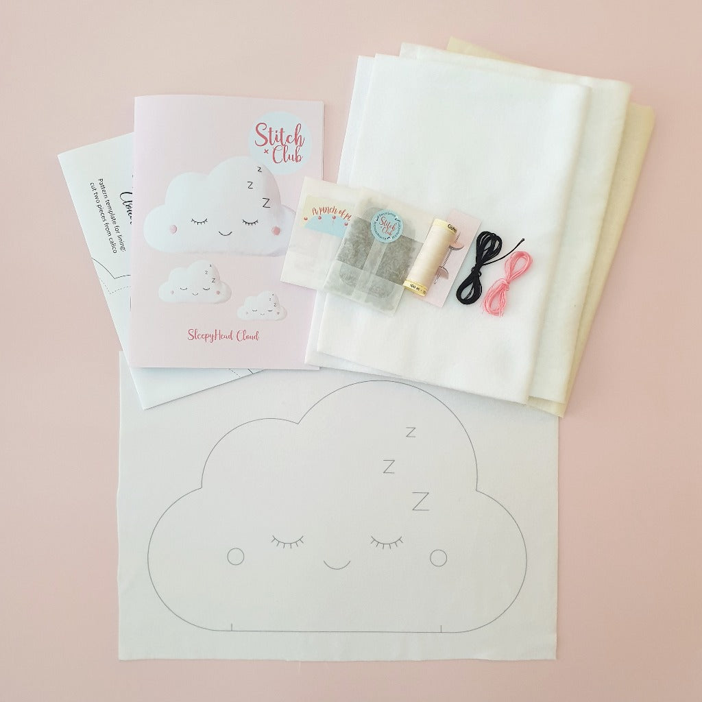 The contents of a sewing kit to make a cloud shaped rice bag warmer filled with soothing lavender. Included is printed fleece fabric, sewing thread, a sewing guide and a bag of dried lavender.