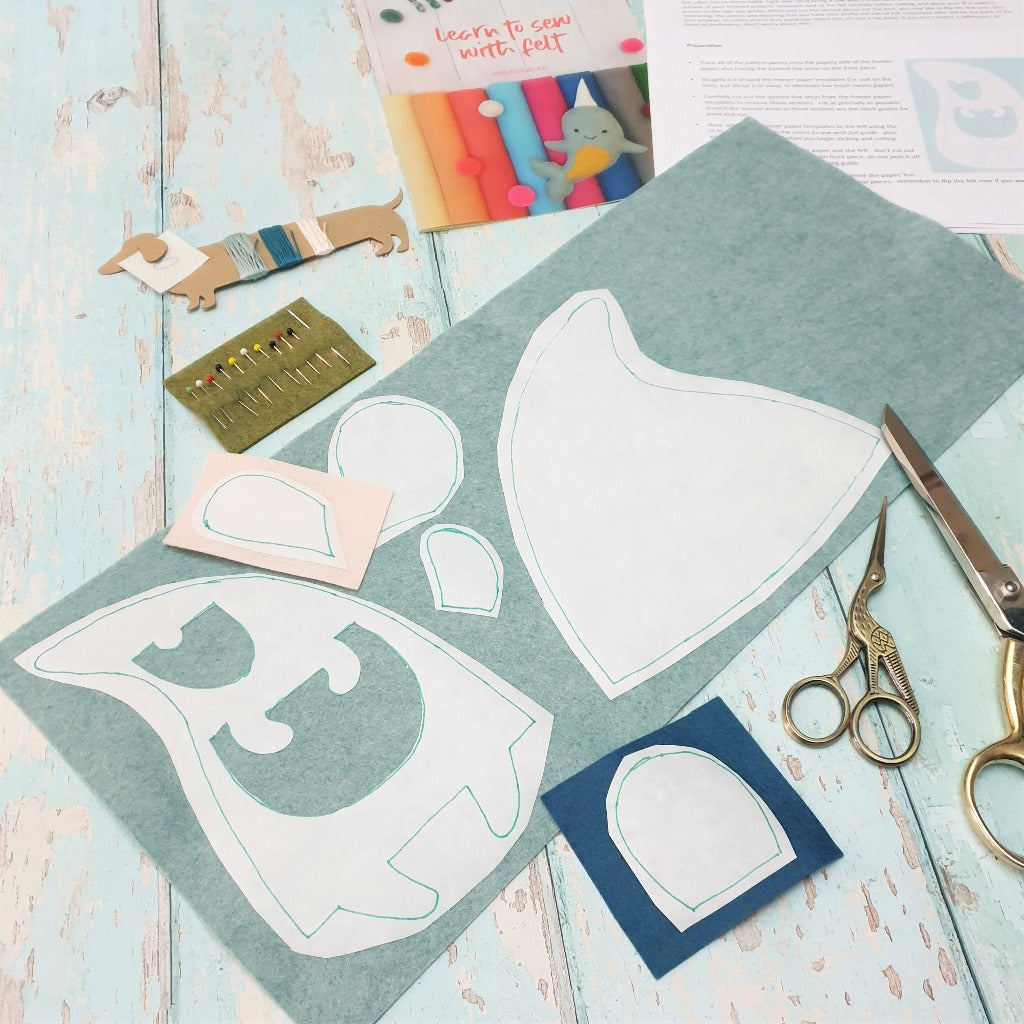 A sewing project in progress, with felt laid out and shapes ready to cut for making a felt mouse