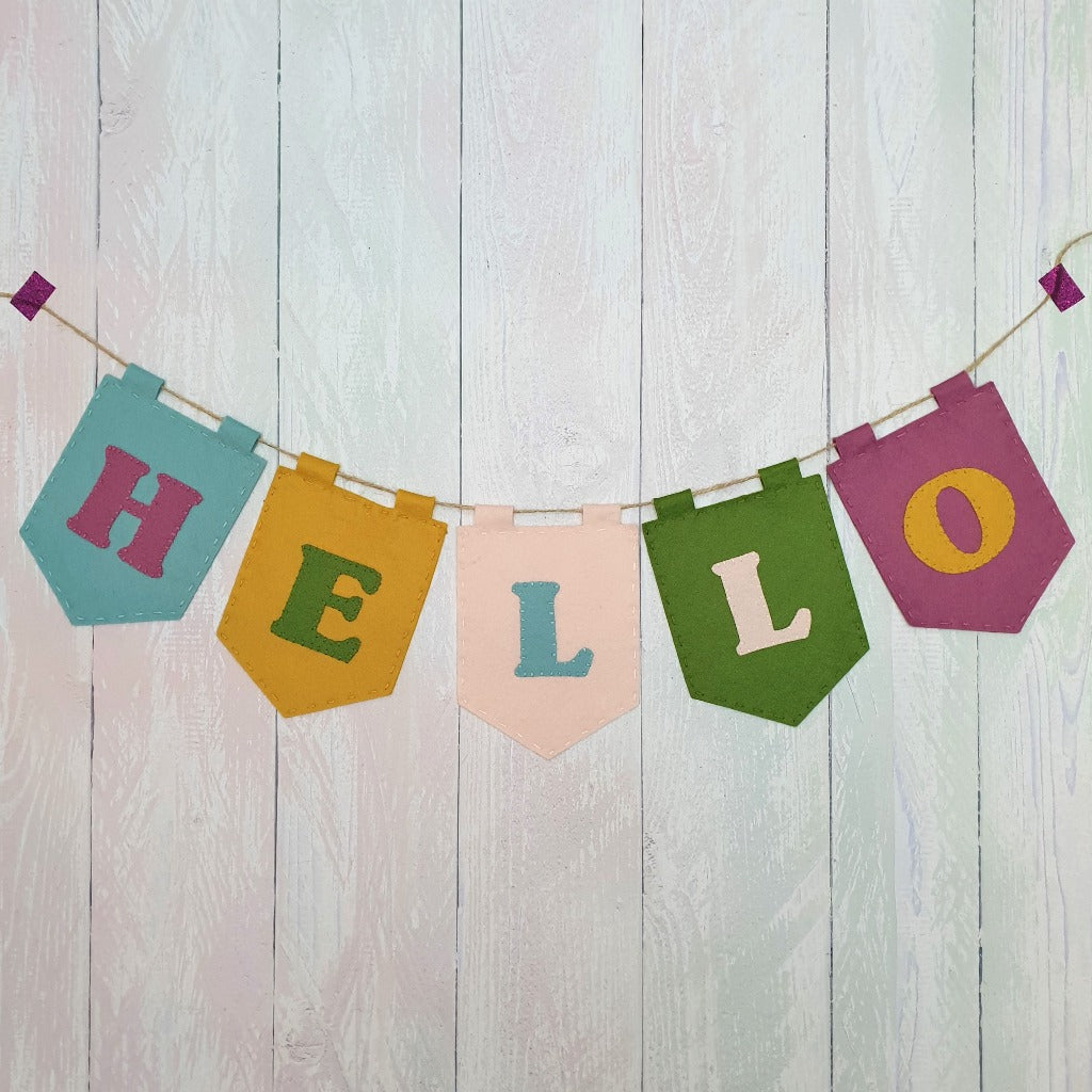 hand sewn hanging colourful felt banner which reads 'hello'