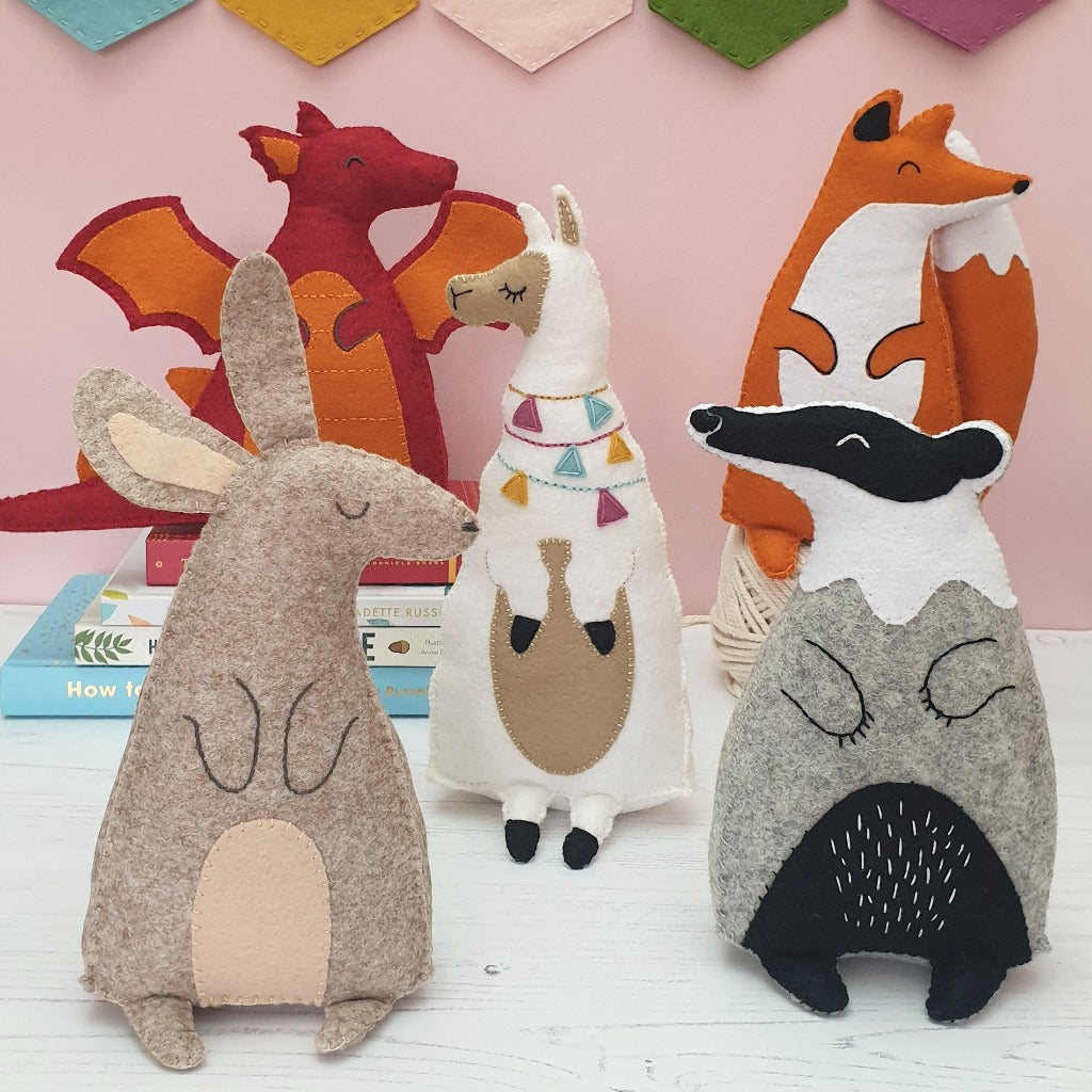 a collection of hand sewn felt animals