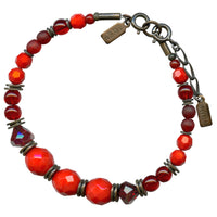 Red Czech glass and Austrian crystal bracelet with bronze accents.