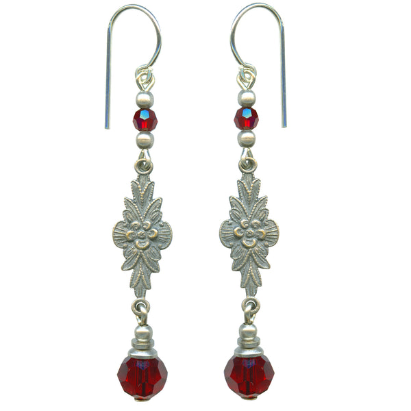 Austrian crystal in siam red with antiqued silver overlay filigree. Ear wires are sterling silver. All handwork done in the USA.