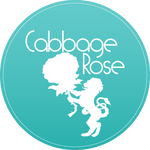 Cabbage Rose Logo with a lion holding a rose