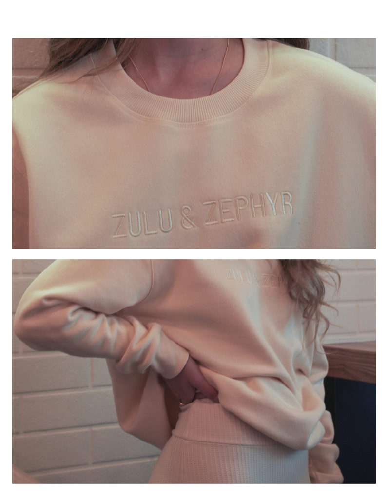 close up images of a caucasian woman wearing a white coloured sweater and shorts