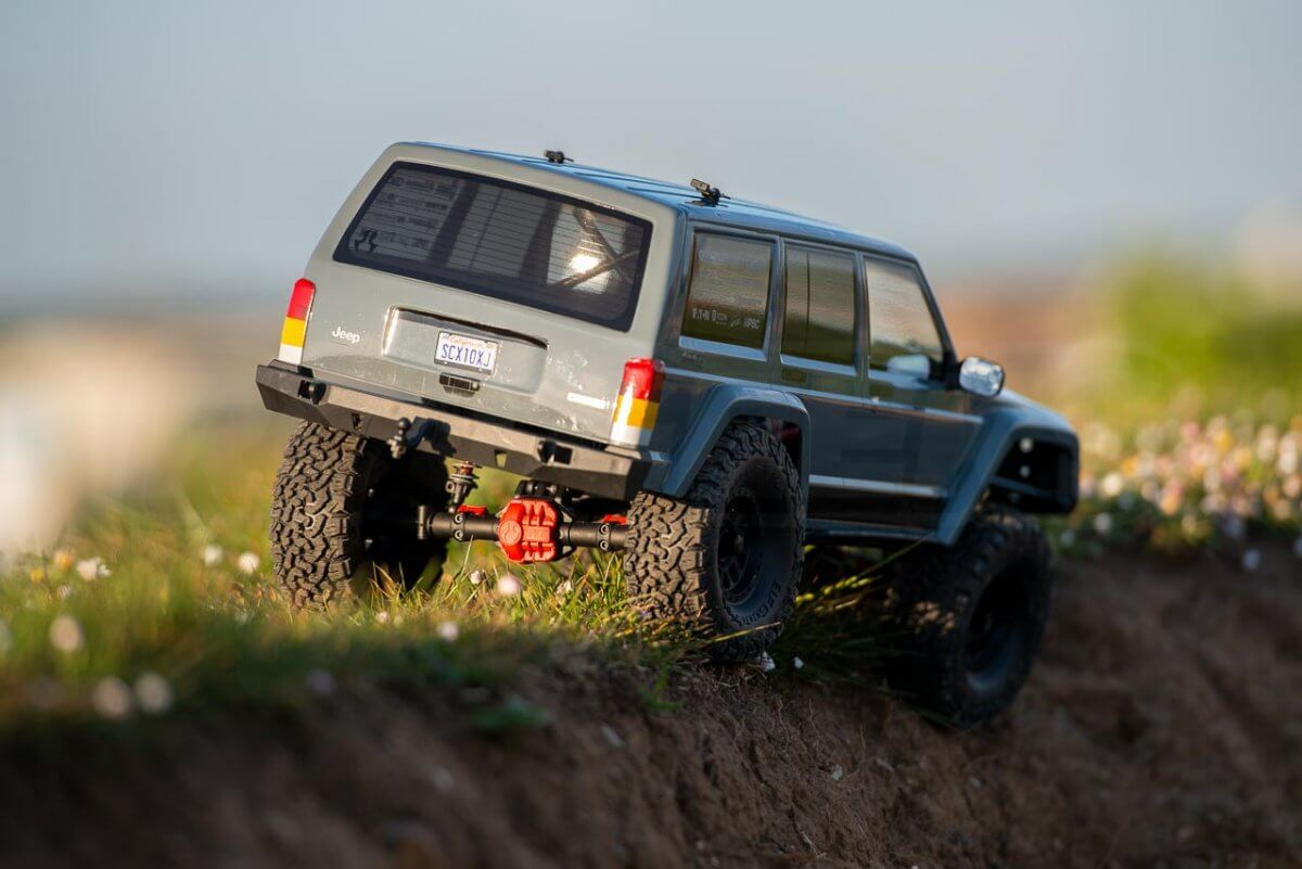 Axial SCX10 II Review Jeep Cherokee crawling on ridge dropping in