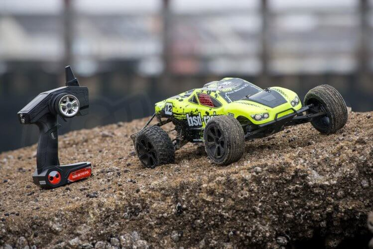 BSD Racing Flux Storm V2 Truggy Review on rock with transmitter
