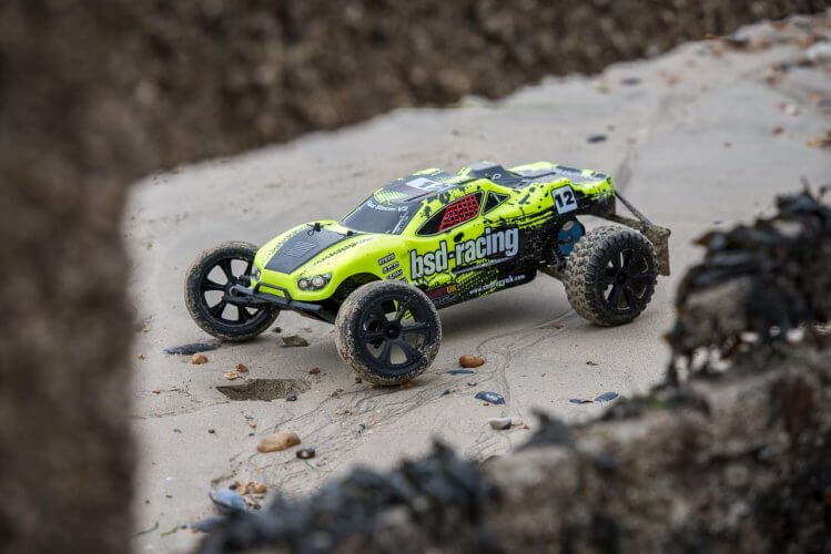 BSD Racing Flux Storm V2 Truggy Review sand front quarter